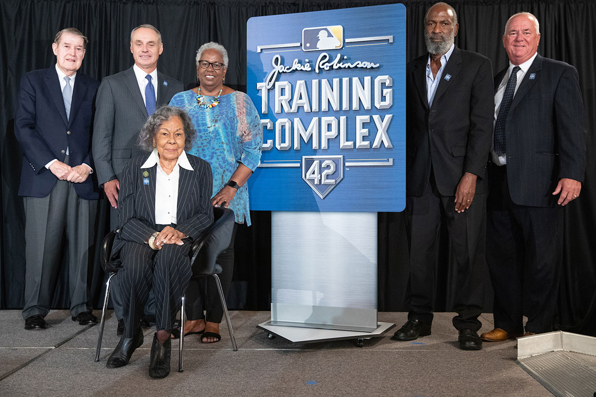 Rachel Robinson (seated), widow of Major League Baseball great Jackie Robinson, daughter Sharon Robinson (behind her) and son David Robinson (second from right) gathered with MLB and local officials to announce Historic Dodgertown's renaming on April 2, 2019. Peter O'Malley, former Dodger owner, is on the left.
